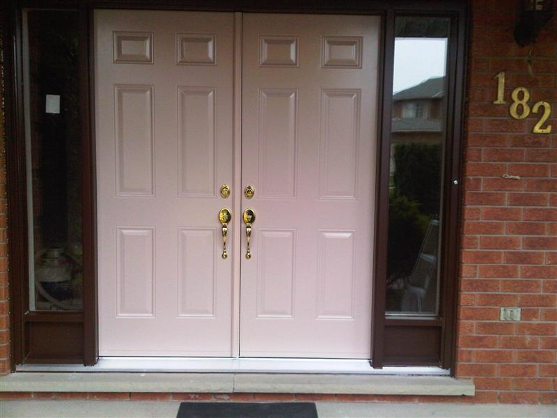 6 panel double doors with clear sidelights on the side