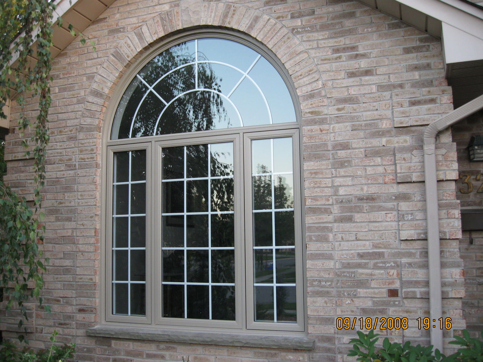 Curved window with grills