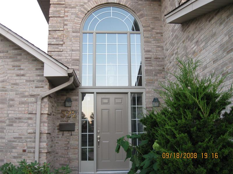 Door with sidelights with large round window above