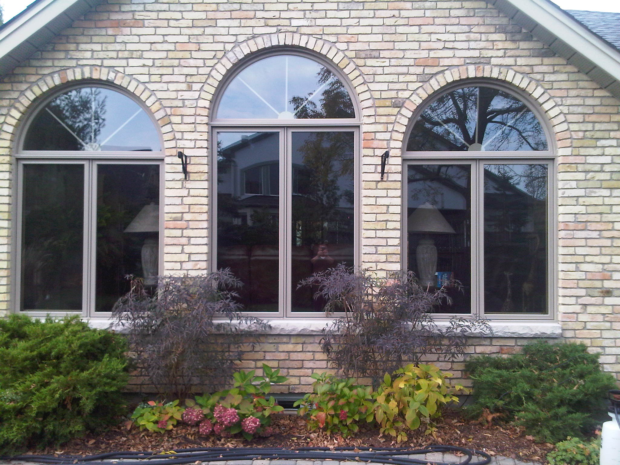 Double casements with curved windows above