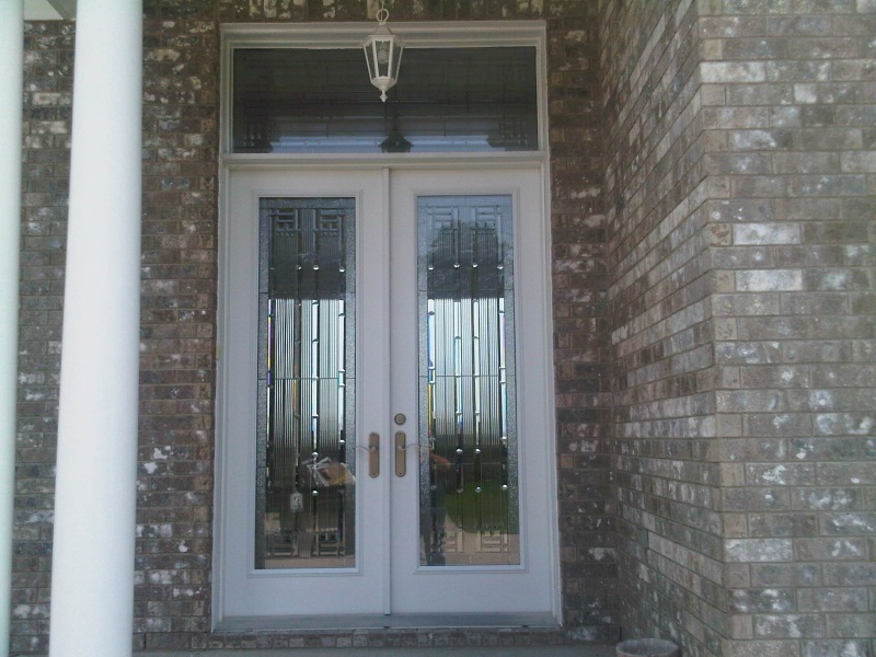 Double steel door with transom