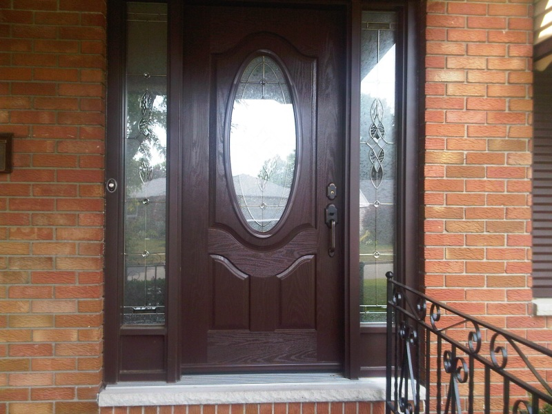 Fiberglass door with clear sidelights