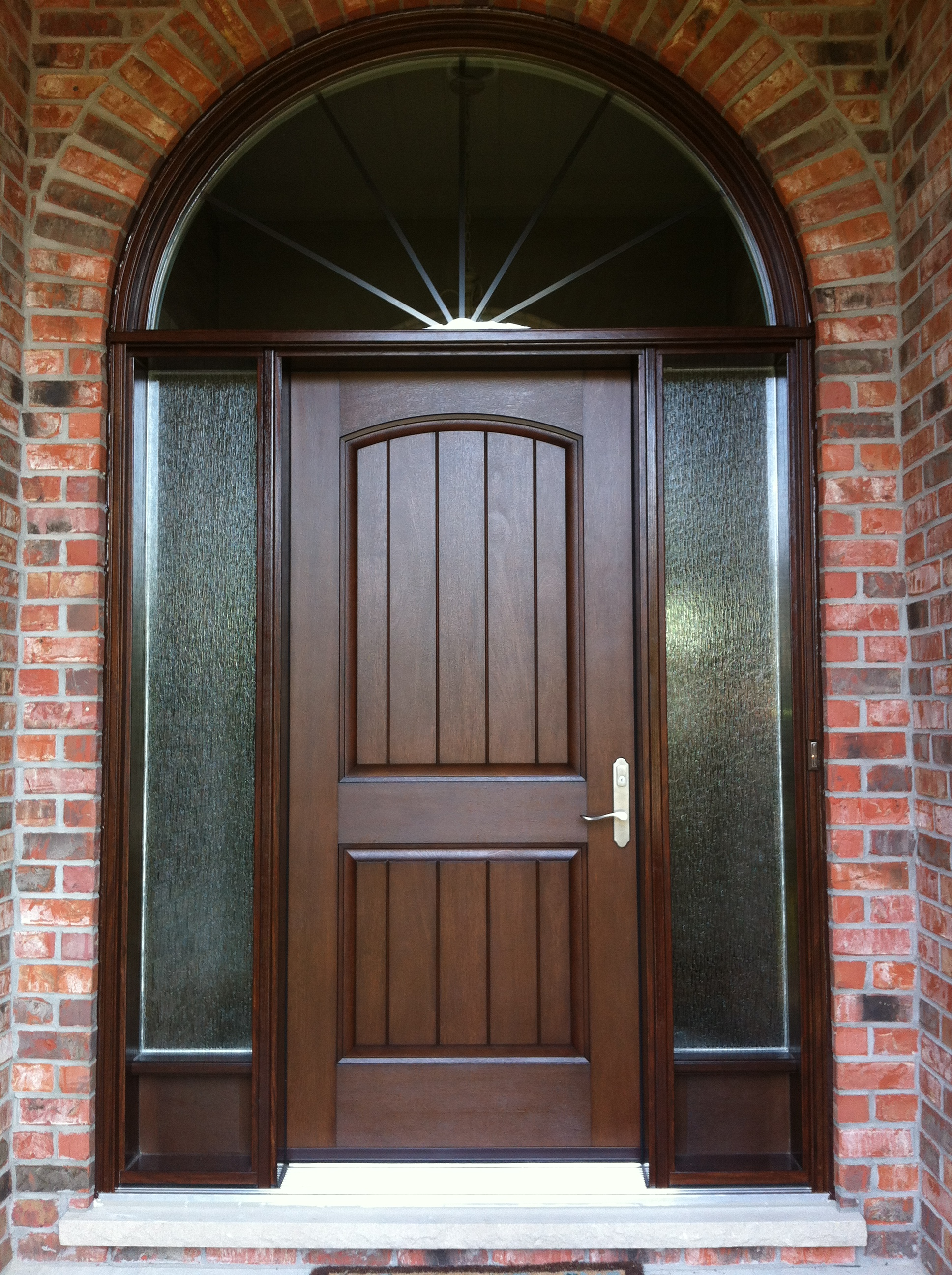 Fiberglass mahogany stained door