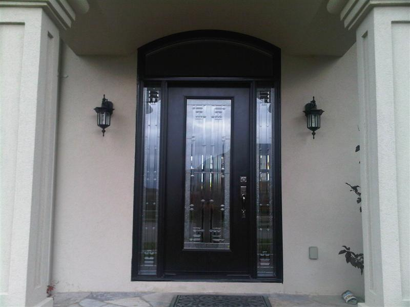 Steel door with segmental transom