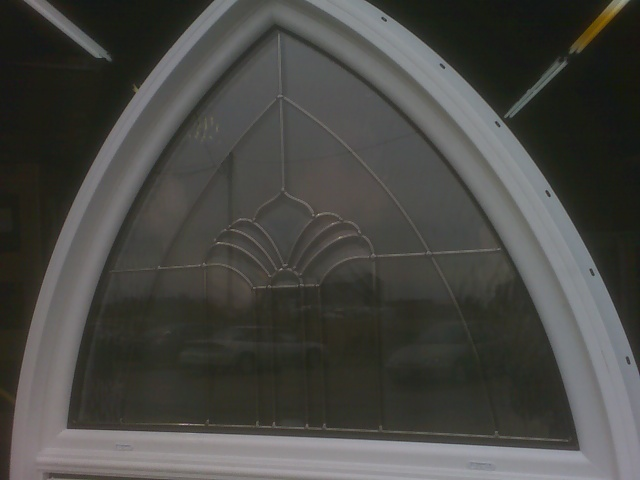 Window with decorative glass